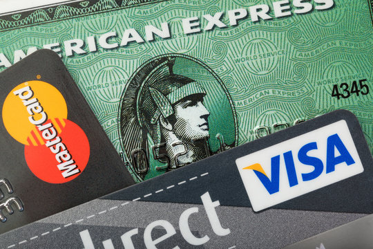 Stade, Germany - September 4, 2019: Closeup studio shot of  credit cards issued by the three major brands American Express, VISA and MasterCard.
