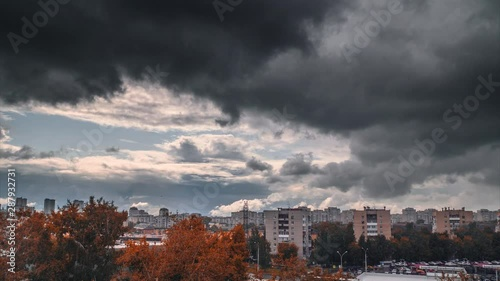 Fotobehang Heavy rainy clouds moving over autumn city skyline. Timelapse, 4K UHD.