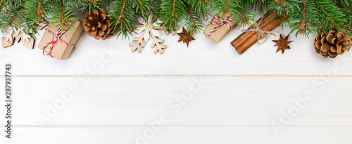 Wall mural Christmas background with copy space, top view. holiday concept for you design on banner wooden table
