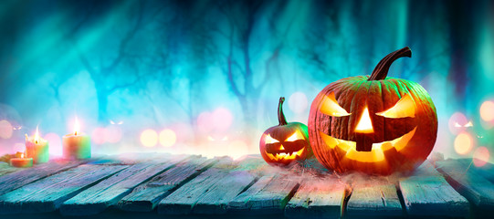Wall Mural - Jack O' Lanterns In Spooky Forest With Ghost Lights - Halloween Background