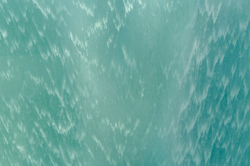 Close up of surface. Blue or turquoise waterfall or swimming pool texture. Pattern background of water. Wall mural