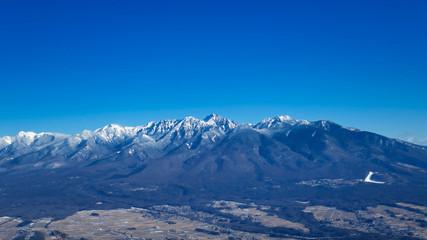 Photo sur Aluminium Bleu fonce 八ヶ岳 雪山 冬 青空 山並