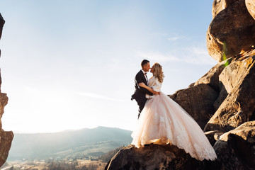 bride in stylish dress with lace and groom in suit. newlyweds hu
