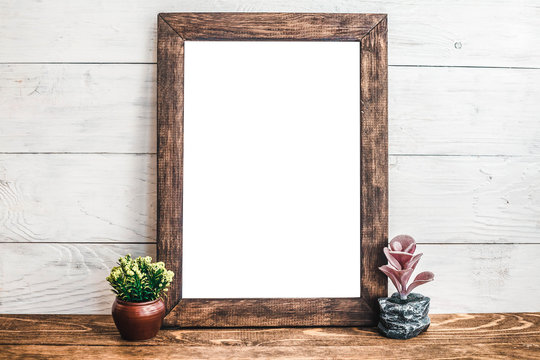 Mockup frame on the boards with decor