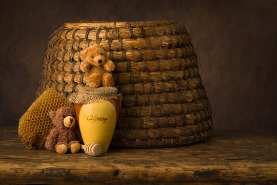 Honey pot and old beehive