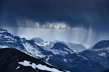 Rocks and mountains in South Tirol Italy with heavy weather