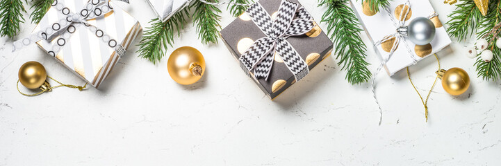 Christmas background with Gold present box and decorations.