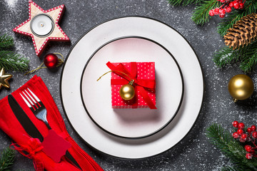Christmas table setting - plate, cutlery and christmas decoratio