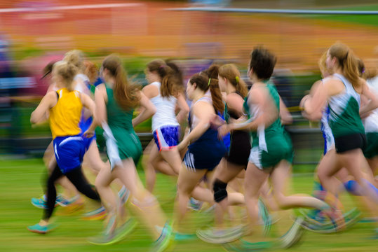 Group of female athletes running.