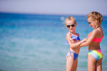 Adorable little girls during summer vacation. Kids enjoy their travel in Mykonos