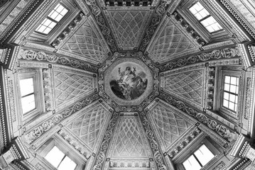 Black and white photo of interior decoration of italian catholic church dome