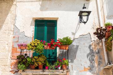 Italy, Apulia, Metropolitan City of Bari, Monopoli. Flowers on a small balcony.