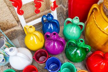 Italy, Apulia, Metropolitan City of Bari, Polignano a Mare. Colorful pottery for sale.