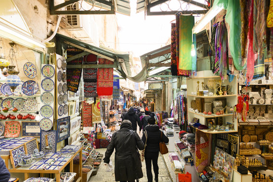 "Locals and tourists at the Mahane Yehuda Market on a busy Friday. Mahane Yehuda Market often referred to as ""The Shuk is a marketplace in Jerusalem, Israel."