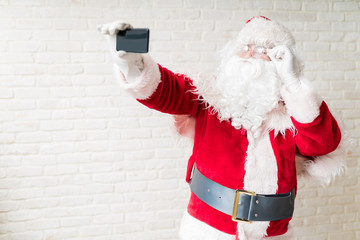 Male photographing self during Christmastime