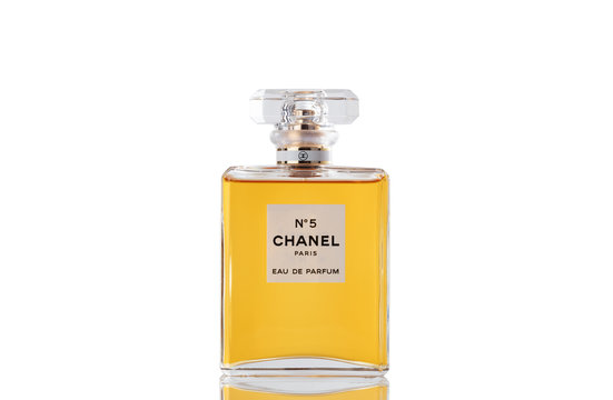 Chanel perfume number five in glass bottle isolated on white background