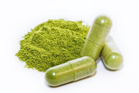 Moringa powder, Moringa oleifera on white background