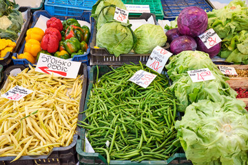 Peas and salad for sale at a market