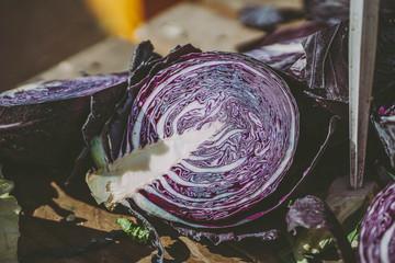 Fresh purple cabbages in outdoor market