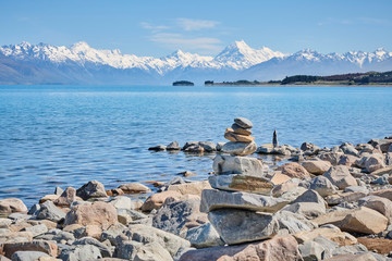 Mount Cook with rock stack in front of Lake Pukaki