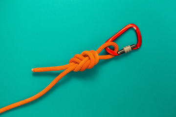 Carabiner and knot from a climbing rope.