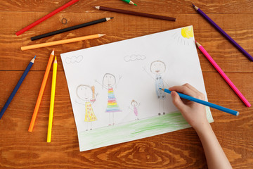 Character Child Drawing Image on Wooden Table