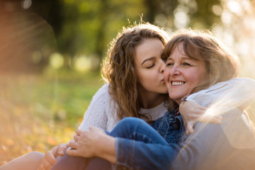 Love - woman being kissed by her adult daughter