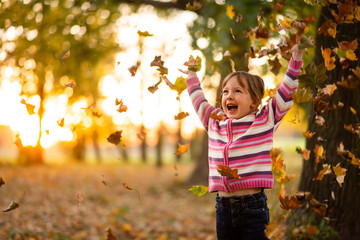 Happiness of little girl child in the month of fall