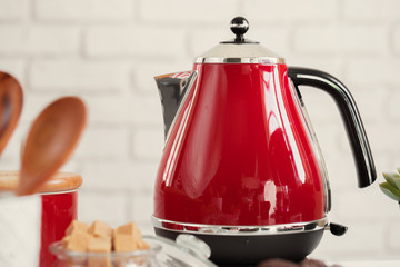 Vintage style red electrical teapot in kitchen interior