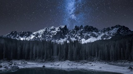 Fototapete - Milky way over Carezza lake and mountain at night, Italy