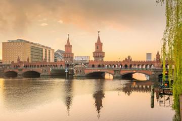 Berlin skyline with Oberbaum Bridge and Spree River, at sunrise