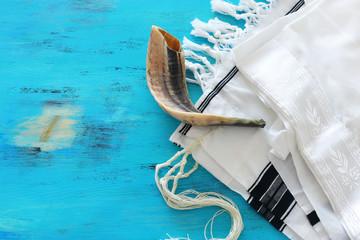 religion image of shofar (horn) on white prayer talit. Rosh hashanah (jewish New Year holiday), Shabbat and Yom kippur concept