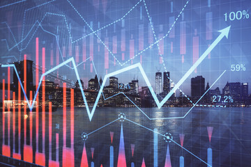Financial graph on night city scape with tall buildings background double exposure. Analysis...