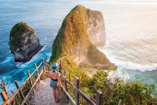 Traveler Exploring Kelingking Beach in Nusa Penida Island, Bali, Indonesia