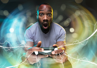 Full immersion in gameplay. Young man holding a video game controller isolated on colorful background. Full of emotions. Leisure activity. Trying to reach the highest level but has the worst team ever