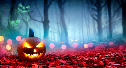 Wall Mural - Pumpkin On Red Leaves In Spooky Forest With Ghost Smoke - Halloween