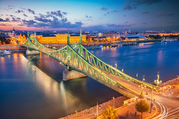 Budapest, Hungary. Aerial cityscape image of Budapest panorama with Liberty Bridge and Danube River during twilight blue hour.