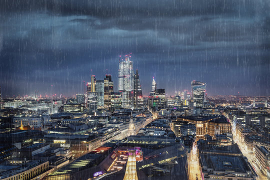 Dark clouds and rain over the City of London, financial hub of United Kingdom