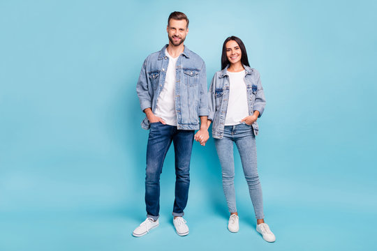 Full length photo of cute people smiling wearing denim jeans jackets isolated over blue background