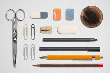 office utensils on paper background