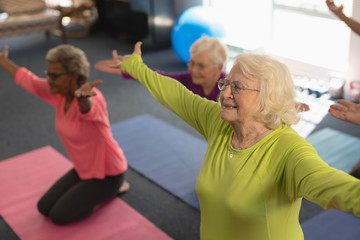 Senior people exercising in fitness studio