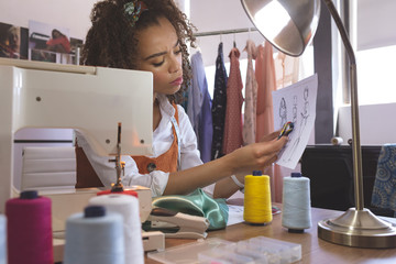 Female fashion designer working in design studio