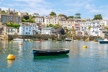 Boats moored at beautiful Cornish harbour town Polruan in South Cornwall, England