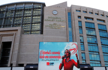 A picture of main opposition CHP's Istanbul chair Canan Kaftancioglu is displayed on a screen outside the Justice Palace in Istanbul