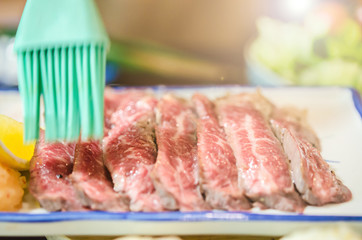 Sliced grilled Strip Loin rare degree of ripeness beef steak.
