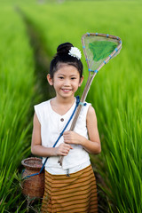Asian girl in rice field with countryside background