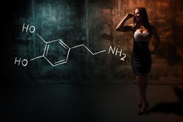 Sexy girl or secretary or female student presenting handdrawn chemical formula o dopamine
