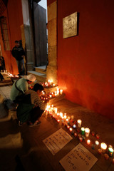 Men place candles outside the Graphic Arts Institute of Oaxaca (IAGO) in memory of late Mexican graphic artist Francisco Toledo, in Oaxaca