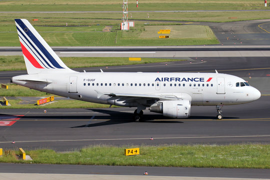 DUSSELDORF, GERMANY - JUNE 7, 2014: Air France Airbus A318-100 with registration F-GUGF on taxiway of Dusseldorf Airport.