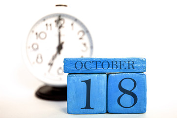october 18th. Day 18 of month, handmade wood calendar and alarm clock on blue color. autumn month, day of the year concept Wall mural
